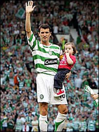 Roy Keane with one of his children at his Old Trafford testimonial
