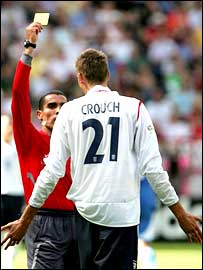 England striker Peter Crouch receives a yellow card against Paraguay