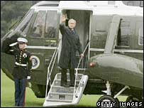 US President George W Bush waves as he boards Marine One in Washington to fly to Camp David