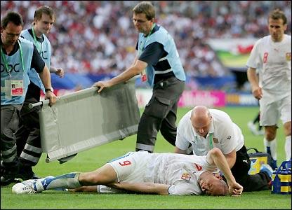 Jan Koller grimaces in pain before being substituted