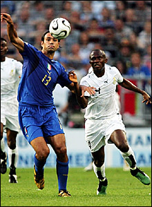 Italy defender Alessandro Nesta holds off the challenge of Matthew Amoah