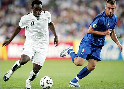 Michale Essien (left) attacks for Ghana