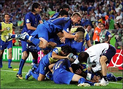 Italy players celebrate their second goal against Ghana