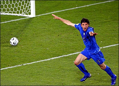 Vincenzo Iaquinta wheels away after scoring Italy's second goal against Ghana