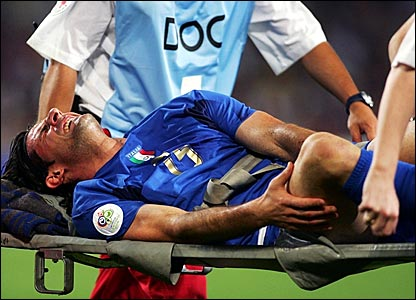 Vincenzo Iaquinta is stretchered off after being brought down by Samuel Kuffour