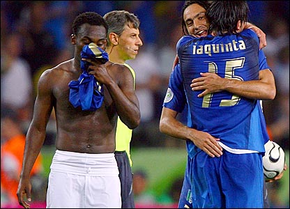 Michale Essien (left) trudges off following Ghana's defeat to Italy