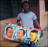 Eric Oppong with his barber's sign