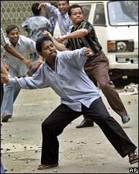 Opposition activists throw brickbats at police during a general strike in Dhaka on Tuesday