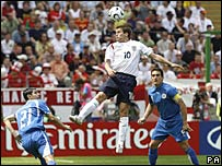 Michael Owen wins a header