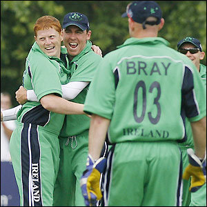 Kevin O'Brien (l) celebrates the wicket of England captain Andrew Strauss