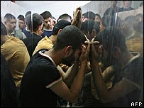 Mourners at a morgue in Gaza following an Israeli air strike