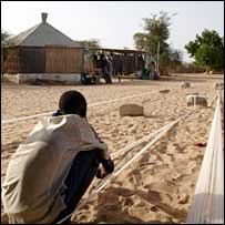 A boy weaves fabric in Ndem, Senegal