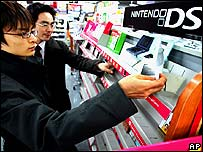 Japanese shoppers looking at the Nintendo DS