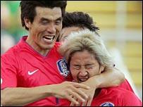 Jin Cheul Choi congratulates opening goalscorer Lee Chun Soo