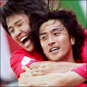 South Korean forward Ahn Jung-Hwan (R) jubilates with a teammate after scoring a second goal for his team