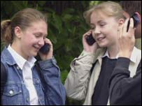 Teenagers on their mobile phones