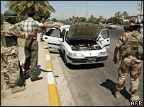 Iraqi troops search car in central Baghdad