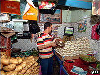 Shop owner watches television in Tunisia