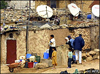 Satellite dishes cover roofs of shacks in the Sidi Moumen slum of Casablanca
