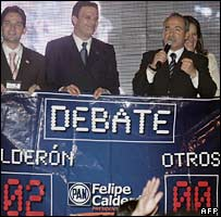 Felipe Calderon (right)  delivers a speech after the last TV debate on 6 June