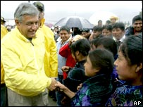 Andres Manuel Lopez Obrador greets people during the election campaign