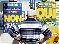 Man looks at campaign posters in French May 2005 referendum on EU constitution