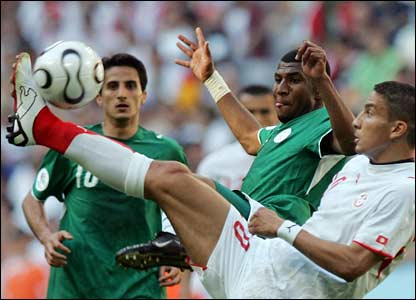 Tunisian midfielder Hamed Namouchi raises his foot in a challenge