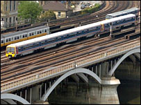 Trains crossing a bridge in London. A strike could be averted.
