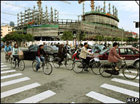 Cyclists at a crossing in Shanghai