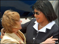 Jamaican PM Portia Simpson Miller (right) greets the visiting Chilean President Michelle Bachelet