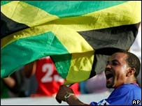 A West Indies' cricket fan waves a Jamaican flag