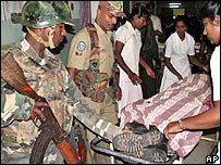 Soldiers attend the dead body of a colleague in hospital