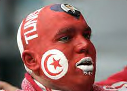 A Tunisia fan in face paint