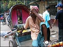 Moizuddin Miah and his rickshaw