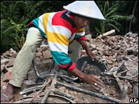 A man recovers a bicycle from a house in Bantul on 12 June 2006