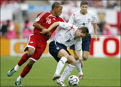 Michael Owen tussles with Densill Theobald