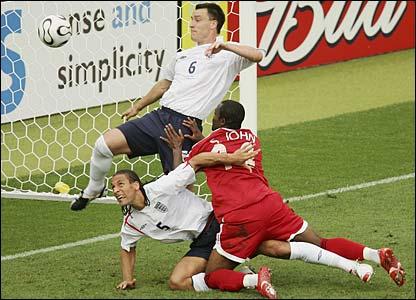 John Terry makes a goal-line clearance from Stern John's header