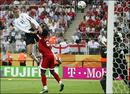 Peter Crouch heads home England's first goal