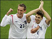 England heroes Peter Crouch (left) and Steven Gerrard celebrate their goals