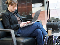 Lady using a laptop at the airport