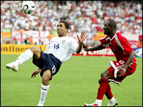 Aaron Lennon (left) in action against Trinidad and Tobago
