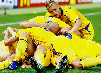 Sweden's players celebrate as the result puts them right back in contention