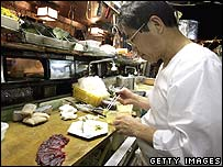 A chef in a Tokyo restaurant serves up whale meat