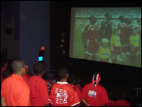 Trinidad and Tobago fans watching match on cinema screen