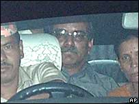 Prachanda (centre) with driver (left) and wife (right) arriving for talks in Kathmandu