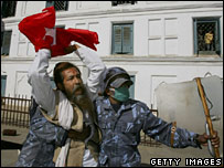 Nepalese soldiers arrest an activist at a pro-democracy rally on 21 January 2006