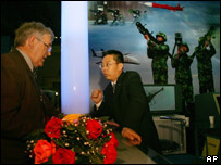 A Chinese salesman with a customer at a defence exhibition in Beijing in April 2006