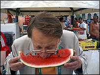Michael Crick bites into a slice of melon