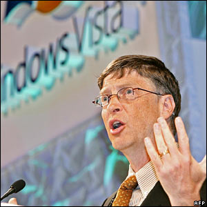 Bill Gates in front of a Microsoft Vista sign