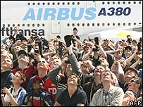 Spectators at an air show standing in front of an A380